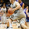 CU<br /> CU's Austin Dufault drives to the basket against Western New Mexico.<br /> Photo by Marty Caivano/Jan. 5, 2010