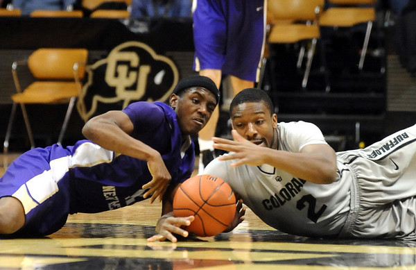 CU<br /> CU's Shannon Sharpe grapples for the ball against TJ Riley of Western New Mexico. <br /> Photo by Marty Caivano/Jan. 5, 2010