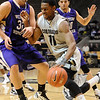 CU<br /> CU's Corey Higgins pushes past Chuck Kempf of Western New Mexico.<br /> Photo by Marty Caivano/Jan. 5, 2010