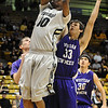 CU<br /> CU's Alec Burks shoots against Brelan Berry of Western New Mexico.<br /> Photo by Marty Caivano/Jan. 5, 2010
