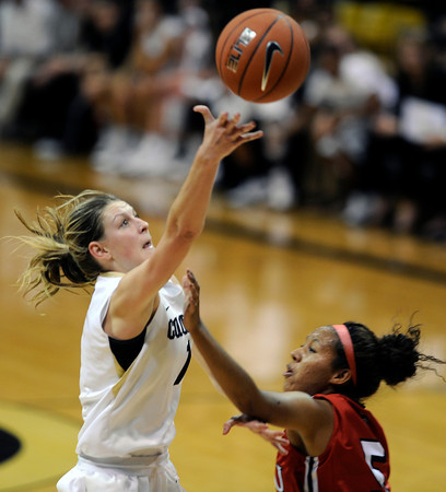 "University of Colorado's Lexi Kresl goes for a layup over Charmayne Bellamy during an exhibition game against Western State on Friday, Nov. 2, at the Coors Event Center in Boulder.  CU won 87-38. For more photos of the game go to  <a href=""http://www.dailycamera.com"">http://www.dailycamera.com</a><br /> Jeremy Papasso/ Camera"