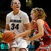 "University of Colorado's Jen Reese drives to the hoop past Maggie Zimmerman during an exhibition game against Western State on Friday, Nov. 2, at the Coors Event Center in Boulder.  CU won 87-38. For more photos of the game go to  <a href=""http://www.dailycamera.com"">http://www.dailycamera.com</a><br /> Jeremy Papasso/ Camera"