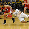 "University of Colorado's Brittany Wilson dives to steal the ball from Desiree Smith during an exhibition game against Western State on Friday, Nov. 2, at the Coors Event Center in Boulder.  CU won 87-38. For more photos of the game go to  <a href=""http://www.dailycamera.com"">http://www.dailycamera.com</a><br /> Jeremy Papasso/ Camera"