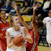 "University of Colorado's Rachel Hargis goes up for a shot over Charmayne Bellamy during an exhibition game against Western State on Friday, Nov. 2, at the Coors Event Center in Boulder.  CU won 87-38. For more photos of the game go to  <a href=""http://www.dailycamera.com"">http://www.dailycamera.com</a><br /> Jeremy Papasso/ Camera"