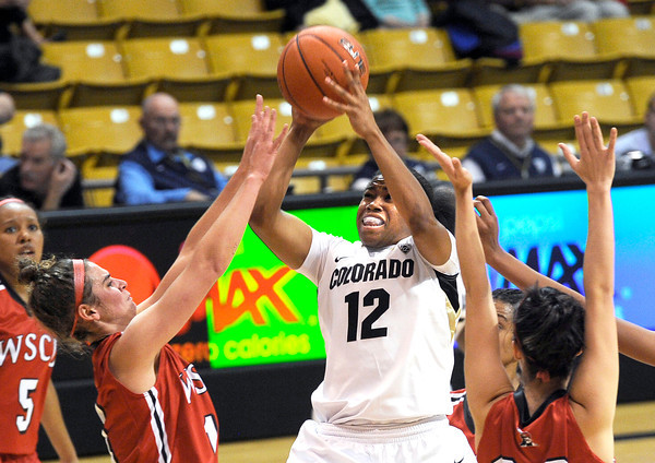 "University of Colorado's Ashley Wilson takes a shot over a swarm of defenders during an exhibition game against Western State on Friday, Nov. 2, at the Coors Event Center in Boulder.  CU won 87-38. For more photos of the game go to  <a href=""http://www.dailycamera.com"">http://www.dailycamera.com</a><br /> Jeremy Papasso/ Camera"