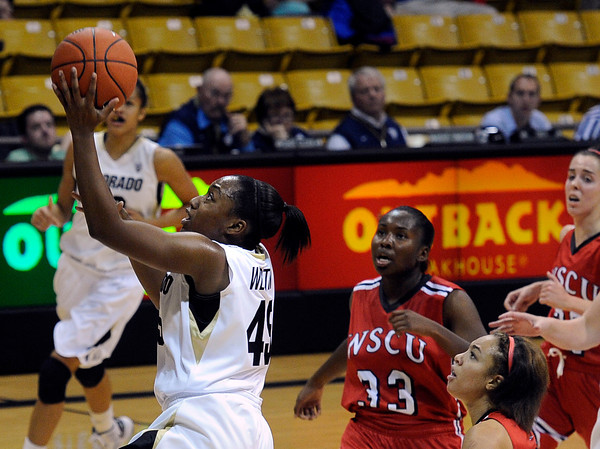 "University of Colorado's Kyleesha Weston goes for a layup in front of Jade Mcintosh, No. 33, and Desiree Smith, at right, during an exhibition game against Western State on Friday, Nov. 2, at the Coors Event Center in Boulder.  CU won 87-38. For more photos of the game go to  <a href=""http://www.dailycamera.com"">http://www.dailycamera.com</a><br /> Jeremy Papasso/ Camera"