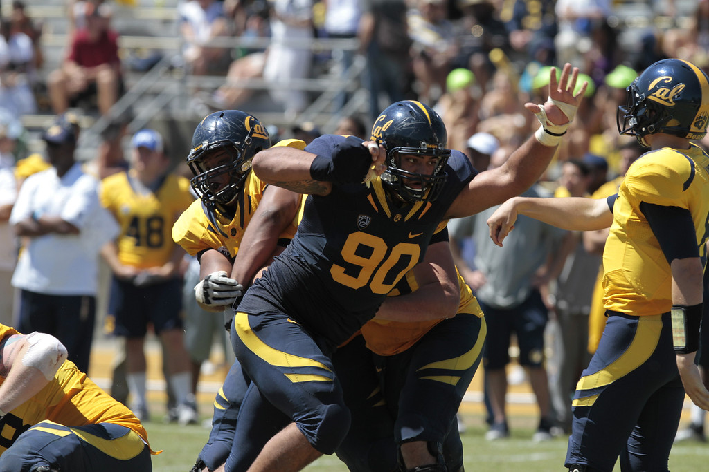 Defensive lineman Mustafa Jalil rushes the quarterback during the Cal Football Spring practice at Edwards Stadium in Berkeley, Calif. on Saturday, April 21st, 2012.