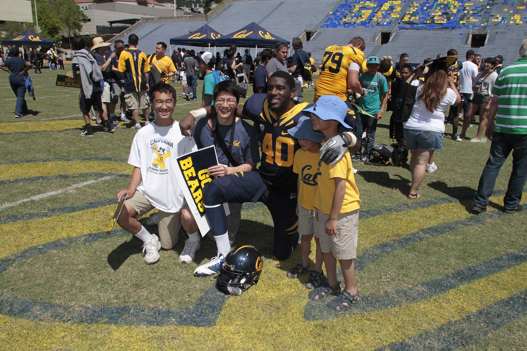 Chris McCain poses with fans during the Cal Football Spring practice at Edwards Stadium in Berkeley, Calif. on Saturday, April 21st, 2012.