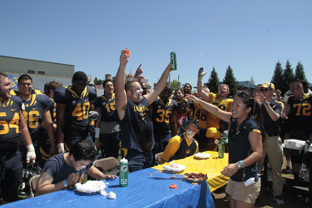 Dominic Galas celebrates winning the pie eating contest at the Cal Football Spring practice at Edwards Stadium in Berkeley, Calif. on Saturday, April 21st, 2012.