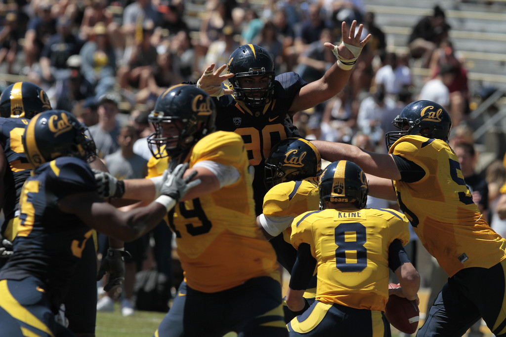 Defensive lineman Mustafa Jalil puts his hands up to block a pass during the Cal Football Spring practice at Edwards Stadium in Berkeley, Calif. on Saturday, April 21st, 2012.