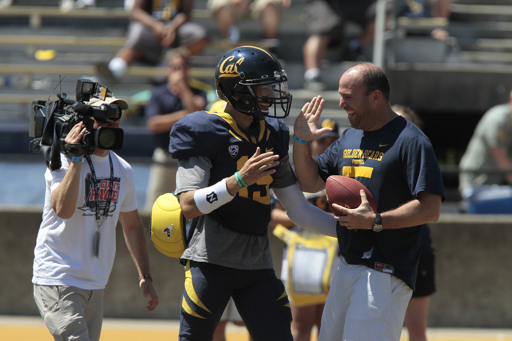 Bruce Denny celebrates with quarterback Zach Maynard after he caught a touchdown pass during a break at the Cal Football Spring practice at Edwards Stadium in Berkeley, Calif. on Saturday, April 21st, 2012. He got to keep the ball if he caught the pass.