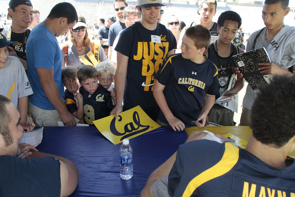Fans wait to get autographs signed during the Cal Football Spring practice at Edwards Stadium in Berkeley, Calif. on Saturday, April 21st, 2012.