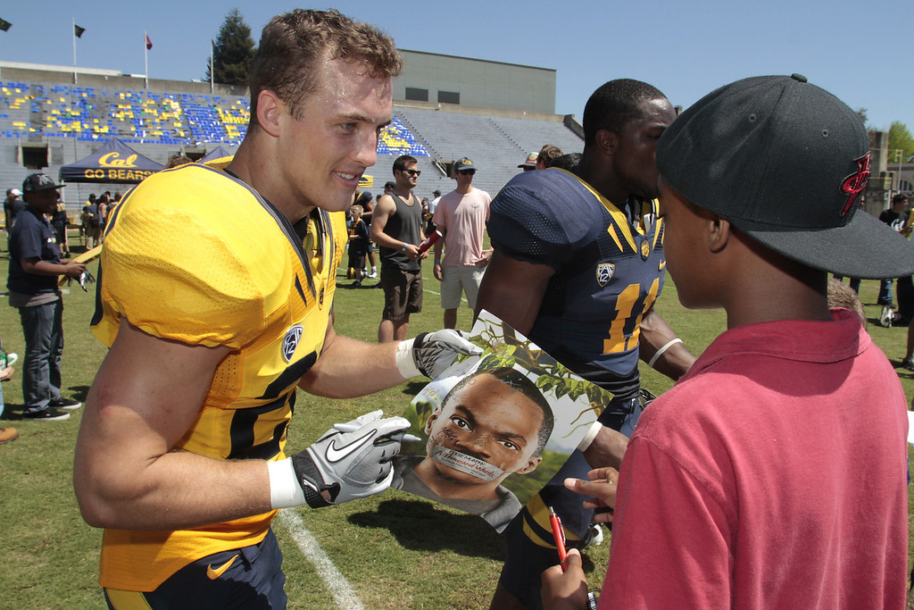 Linebacker Matt Mayes signs an autograph for a fan during the Cal Football Spring practice at Edwards Stadium in Berkeley, Calif. on Saturday, April 21st, 2012.