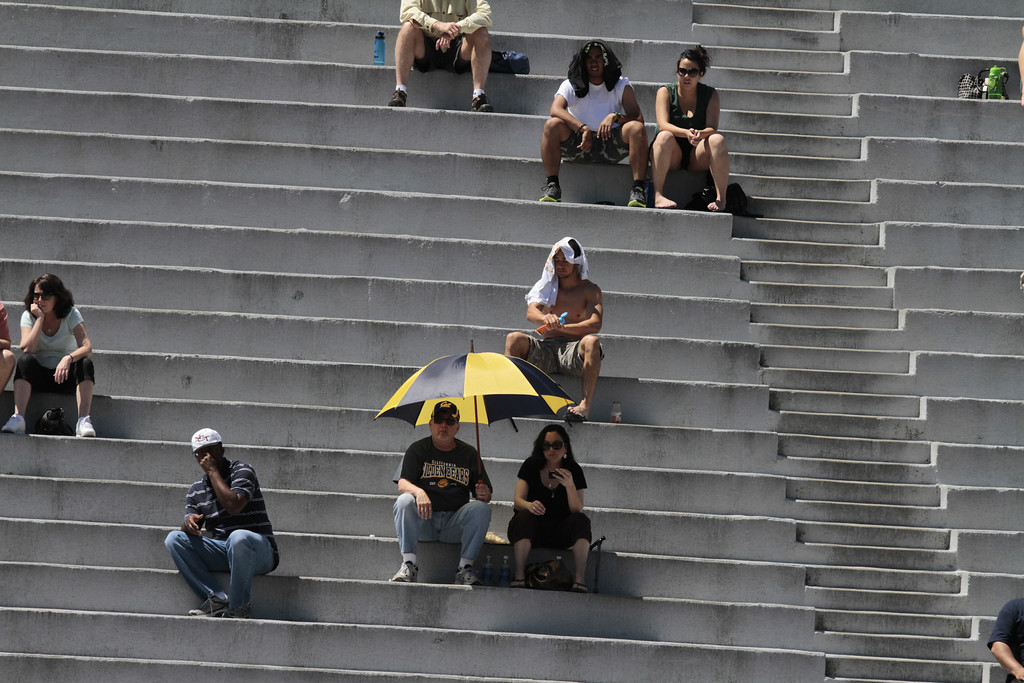 People sit in the sun and watch the Cal Football Spring practice at Edwards Stadium in Berkeley, Calif. on Saturday, April 21st, 2012.