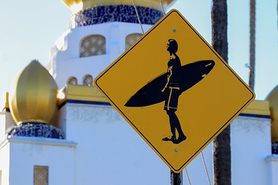 Signage at Swamis with temple in background. This is downtown Encinitas.