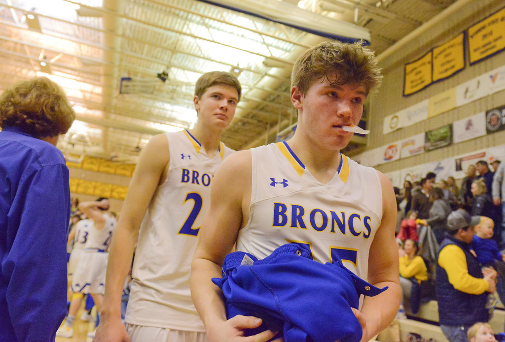 Justin Sheely | The Sheridan Press<br /> <br /> Sheridan's Gus Wright, left, and Tristan Bower leave the court after the Broncs fall to Campbell County High School at Sheridan High School Thursday, Feb. 1, 2018. The Camels eased past Sheridan 63-48.