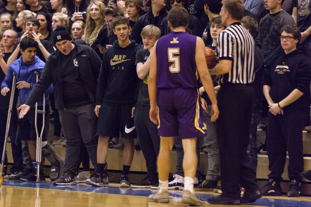Tibby McDowell | The Sheridan Press<br /> <br /> The Sheridan High School student body cheering section heckles Shayne Belt of Campbell County High School at Sheridan High School Thursday Feb. 1, 2018. The Camels eased passed Sheridan 63-48.