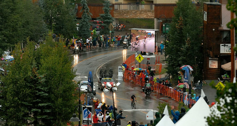 RIDER ON THE STORM  :  Heavy rain, thunder , lightning ....Robin Carpenter  climbing to the finishing line  and winning th 2nd stage . of the  Usa Pro Cycling Challenge  in Mt Crested-Butte Co