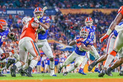 Miami Gardens, Florida-December 30, 2019:  Florida Gators running back Lamical Perine (2)   during the Capital One Orange Bowl at Hard Rock Stadium on December 30, 2019 in Miami Gardens, Florida.