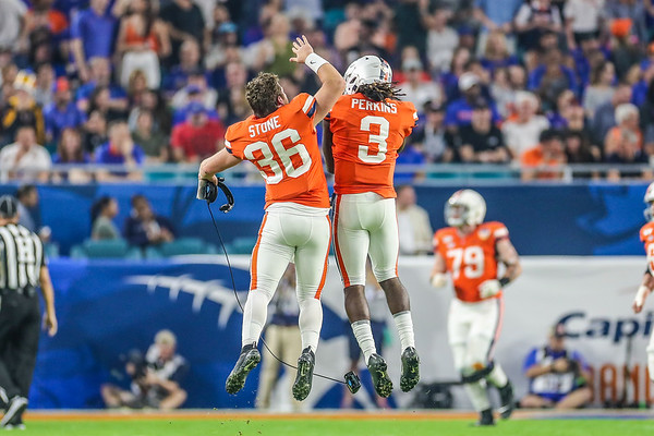 Miami Gardens, Florida-December 30, 2019: Virginia Cavaliers quarterback Lindell Stone (36) and Virginia Cavaliers quarterback Bryce Perkins (3) during the Capital One Orange Bowl at Hard Rock Stadium on December 30, 2019 in Miami Gardens, Florida.