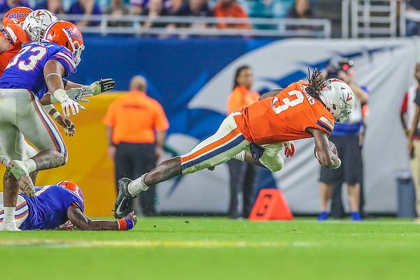 Miami Gardens, Florida-December 30, 2019: Virginia Cavaliers quarterback Bryce Perkins (3) during the Capital One Orange Bowl at Hard Rock Stadium on December 30, 2019 in Miami Gardens, Florida.