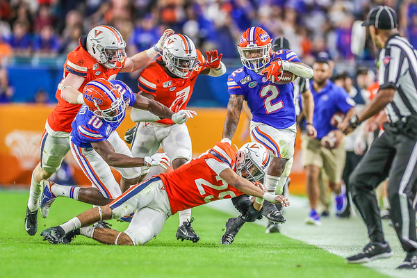 Miami Gardens, Florida-December 30, 2019: Florida Gators running back Lamical Perine (2), Florida Gators wide receiver Josh Hammond (10), Virginia Cavaliers defensive back Joseph White (25), Virginia Cavaliers safety Chris Moore (7) and Virginia Cavaliers linebacker Zane Zandier (33) during the Capital One Orange Bowl at Hard Rock Stadium on December 30, 2019 in Miami Gardens, Florida.