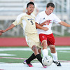 Neosho's Walfre Hernandez and Carl Junction's Paul LeFerbve compete for control of the ball Monday evening, Sept. 23, 2013, at Carl Junction's field.<br /> Globe | T. Rob Brown