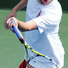 Globe/T. Rob Brown<br /> Carl Junction No. 1 singles Ben Coltharp returns the ball to Thomas Jefferson's Frank Cascone Wednesday afternoon, May 8, 2013, at Millenium Tennis & Fitness in Joplin.