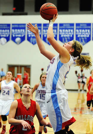 Globe/T. Rob Brown<br /> Webb City's Desirea Buerge takes a shot over Carl Junction's Bryce Boyd during the District 12 Class 4 Basketball Tournament Thursday evening, Feb. 28, 2013, at Carthage High School's gymnasium.