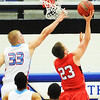 Globe/T. Rob Brown<br /> Webb City's Kohl Slaughter gets his hands caught in the net while attempting to block a shot by Carl Junction's Hunter McPherson during the District 12 Class 4 Basketball Tournament Friday evening, March 1, 2013, at Carthage High School.