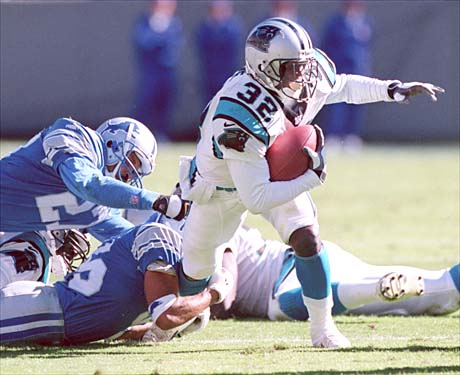 10/24/99  Carolina Panthers runnign back Fred Lane is tackled by Detroit Lions safety #27 Mark Carrier in the 4th quarter at Ericsson Stadium in the Panthers 24-9 loss.