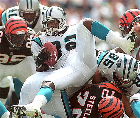 09/26/99:  Carolina Panthers Fred Lanes glides over the pile  as he pushes to get through the defense of the Cincinnati during the third quarter of action Sunday afternoon. The panthers went on to win 27-3.