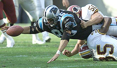 10/03/99:  Landover,MD:  Carolina Panther's   Wesley Wall streches as he attempts to pull in a catch Sunday afternoon between Redskin's Derek Smth (50) and teammate Leomont Evans during the first quarter of action. Washington went on to beat the Panthers 38-36.