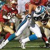 10/17/99: SanFrancisco, CA:  Carolina Panther's Patrick Jeffers pushes his way past SanFrancisco's Mark McMillian (29) and teammate Ken Norton Jr., after making a catch in the third quarter of action. The  Carolina Panthers went on to Win 31-29 Sunday afternoon.