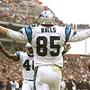 11/21/99: Carolina Panther's Wesley Walls celebrates with teammate William Floyd after Walls caught a pass for a touchdown in the  second quarter of play Sunday afternoon against the Cleveland Browns. Cleveland Brown's James Williams (90) looks away in disgust. The Panthers went on beat Cleveland 31-17.