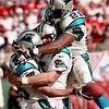 Carolina Panthers wide receiver Patrick Jeffers, left, is congratulated by teammates tight end Wesley Walls, center, and running back Tshimanga Biakabutuka (21) in the third quarter against the San Francisco 49ers, Sunday, Oct. 7, 1999 in San Francisco. The Panthers beat the 49ers 31-29. (AP Photo/Paul Sakuma)