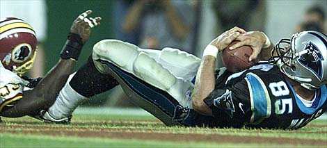 10/03/99:  Landover,MD:  Carolina Panthers Wesley Walls pulls in a touchdown catch in front of Washington Redskin's Marco Coleman during the fourth quarter of action. The  Washington Redskins went on to beat the Panthers 38-36.