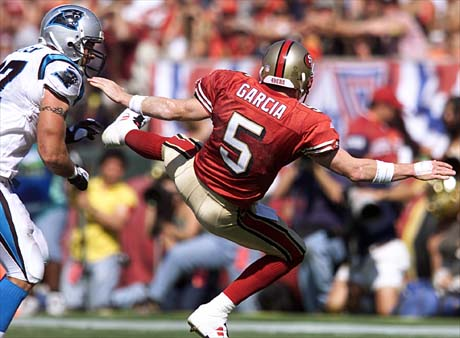 10/17/99: SanFrancisco, CA:  Carolina Panther's  Jason Peter knocks SanFrancisco's Quarterback Jeff Garcia on his butt during the first half of action. The  Carolina Panthers went on to Win 31-29 Sunday afternoon.