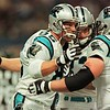 11/14/99 Carolina Panther tight end (85) Wesley Walls is congratulated by teammate (65) Frank Garcia and another teammate following Wall's touchdown reception during first quarter action Sunday vs the St. Louis Rams at the Trans World Dome in St. Louis, MO.  The Rams defeated the Panthers 35-10.