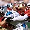 10/17/99: SanFrancisco, CA:  Carolina Panther's Quarterback Steve Beuerlein gets sacked by    SanFrancisco's  Tim McDonald (46) and teammate Winfred Tubbs.The  Carolina Panthers went on to Win 31-29 Sunday afternoon.