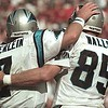 10/17/99: SanFrancisco, CA:  Carolina Panther's Wesley Walls  celebrates with quarterback Steve Beuerlein after Walls ran in a touchdown Sunday afternoon against SanFrancisco.  The  Carolina Panthers went on to Win 31-29 Sunday afternoon.