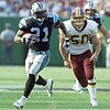 10/03/99:  Landover,MD:  Carolina Panther's Tshimanga Biakabutuka runs in his third touchdown of the first quarter past the defense of Washington Redskin's Derek Smith Sunday afternoon.  Washington went on to beat the Panthers 38-36.