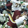 10/03/99:  Landover,MD:   Washington Redskin's quarterback Brad Johnson gets sacked by Carolina Panther's Jason Peter (97) and teammate Michael Barrow Sunday afternoon.  Washington went on to beat Carolina 38-36.