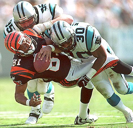 09/26/99:  Carolina Panthers Dean Wells (left) and teammate Mike Minter (30) work to stop  Cincinnati's Carl Pickens during the second quarter of action Sunday afternoon. The Panthers went on to win 27-3.