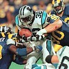 11/14/99 Carolina Panther (32) running back Fred Lane tries to gain a few extra yards as St. Louis Rams defenders (59) London Fletcher and (90) Jeff Zgonina try to make the tackle at the Trans World Dome in St. Louis, MO. The Rams defeated the Panthers 35-10.