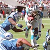 10/24/99  Panthers #32 Fred Lane puts his head down and drives through a hole in the Lions line in the first quarter.