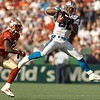 Carolina Panthers' Eric Metcalf (82) pulls in a pass over San Francisco 49ers' cornerback R.W. McQuarters in the third quarter Sunday, Oct. 17, 1999,  in San Francisco. Carolina defeated San Francisco, 31-29.  (AP Photo/Ben Margot)