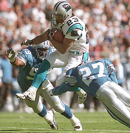 10/24/99:   Carolina Panthers Anthony Jonson leaps over the defense of Detroit Lions Richard Jordan (99) and teammate Mark Carrier during the third  quarter of action Sunday afternoon.