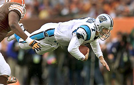 11/21/99: Carolina Panther's Quaterback Steve Beuerlein flies through thre for first down yardage  Sunday afternoon past the defense of the Cleveland Brown. The Panthers went on beat Cleveland 31-17.