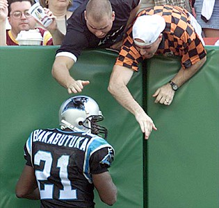 10/03/99:  Landover,MD:  Carolina Panther's Tshimanga Biakabutuka celebrates with fans in the  endzone after running in his second of three touchdowns that he scored in the first quarter Sunday afternoon against the Washington Redskins .Washington went on to beat Carolina 38-36.